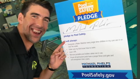 Michael Phelps with his signed pledge.
