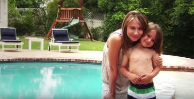 Mother and son in front of pool