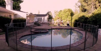 photo of a pool with fencing around it.