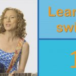 woman playing guitar with a graphic that says 1, learn to swim.