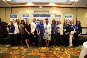 A group of women with 1 man at the NDPA conference