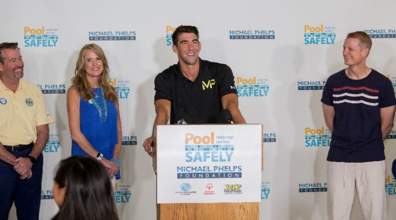 Michael Phelps in front of podium