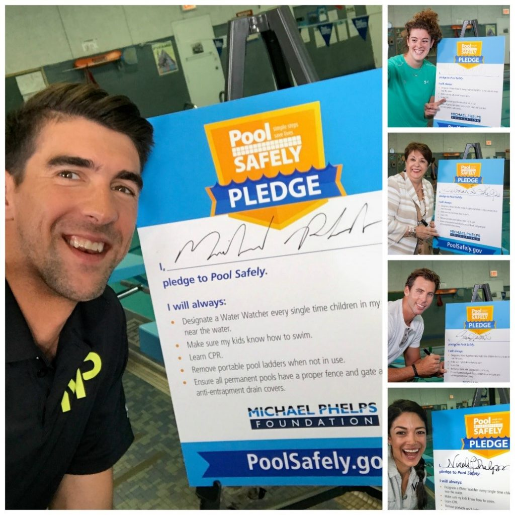 Michael Phelps and friends with their signed pool safely pledge