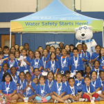 Campers in a gym for Water safety.
