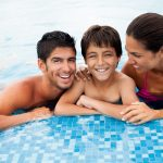 A cheerful family in a swimming pool.