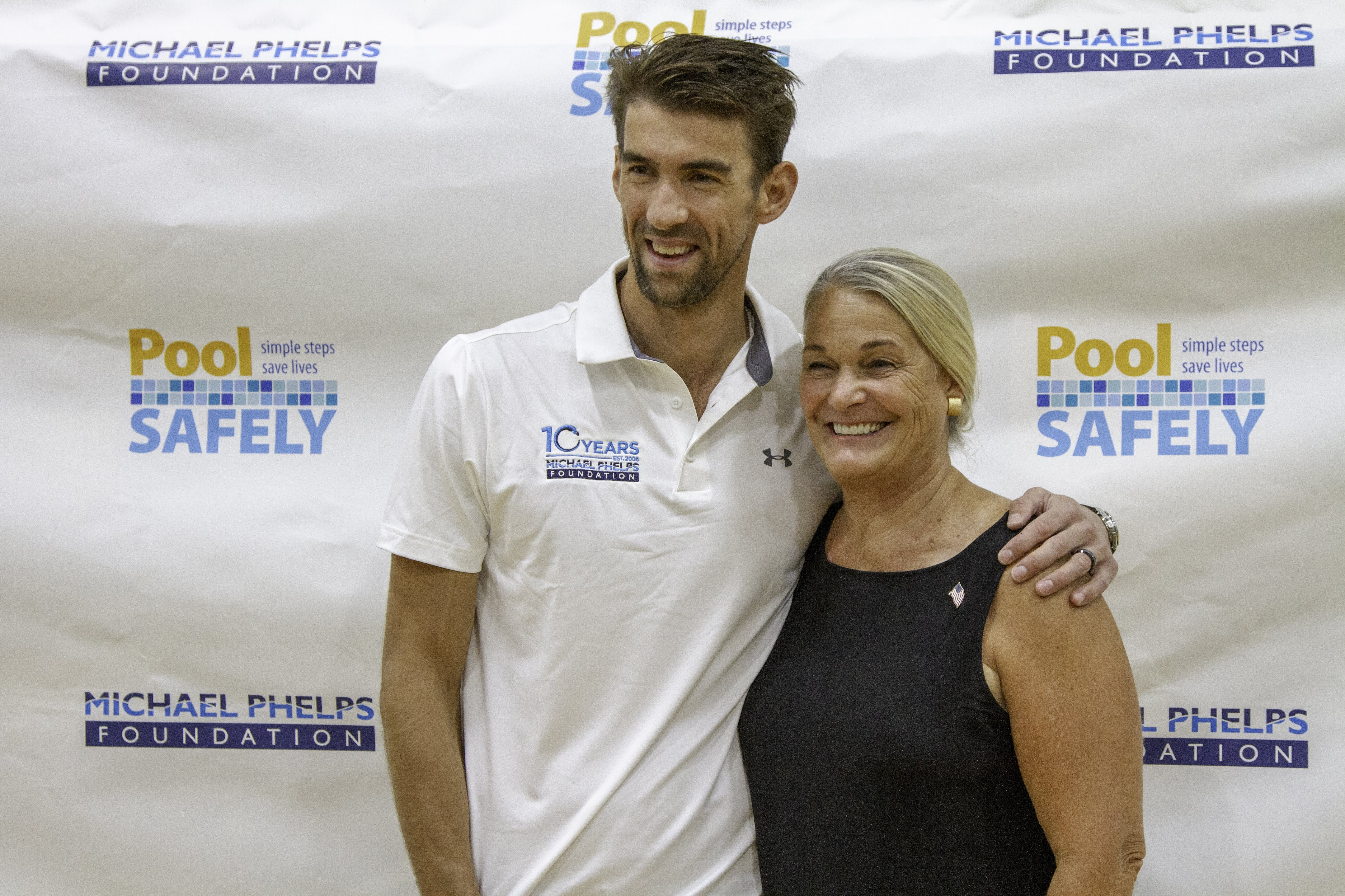 michael phelps and ann marie buerkle smiling.