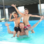 Dad and Kids Swimming.
