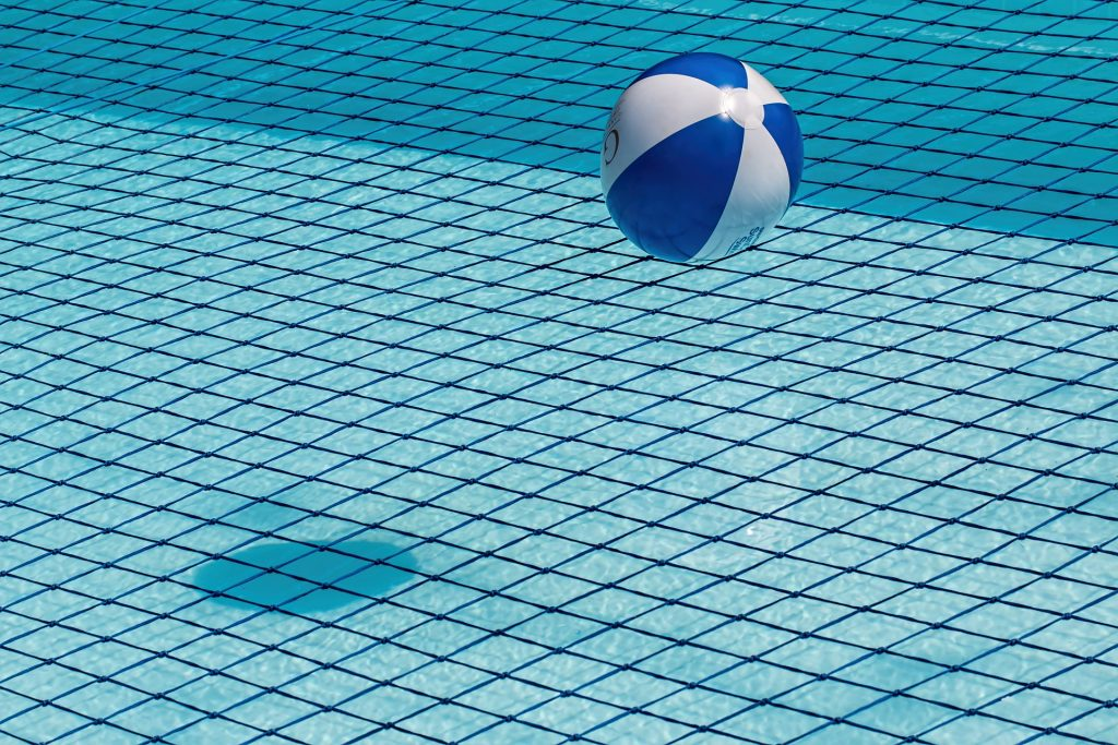 beach ball on a pool net.