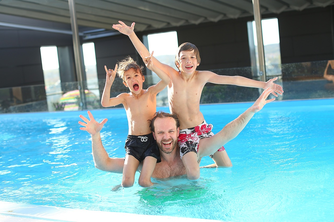 Dad and Kids Swimming