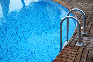 closeup of a pool and pool ladder.