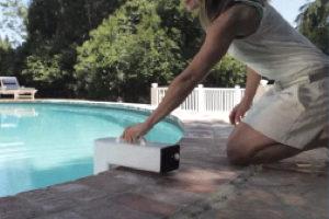 a woman installing a pool alarm.