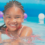 closeup of a young girl in an inflatable pool.