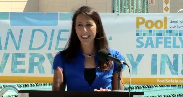 closeup of a woman at a podium